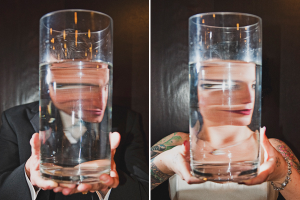 bride and groom with distorted faces through water filled vases - hilarious couple's portrait - genius alternative wedding portrait by Bay Area photographers The Image is Found