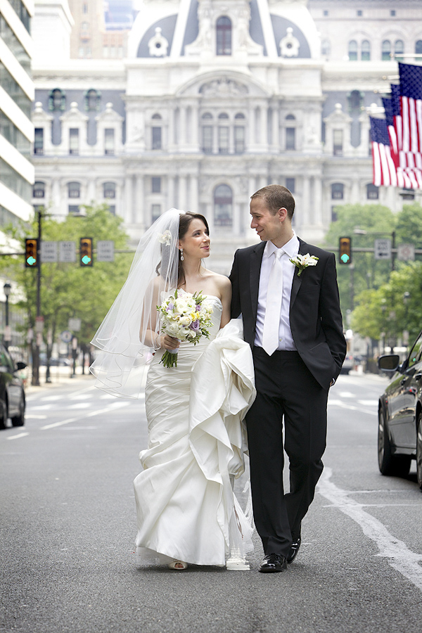 bride and groom walking down street in downtown Philadelphia - photo by top Philadelphia photographers Langdon Photography