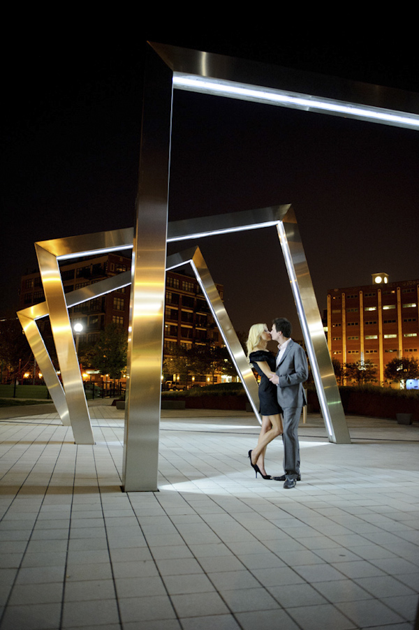gorgeous night shot of couple under Chicago sculpture art - creative engagement photo by Chicago based photographers Nakai Photography