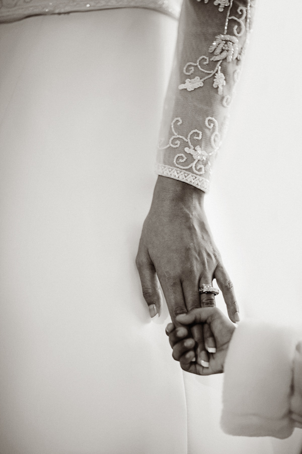 adorable and lovely wedding photo of a bride and child holding hands, image by Roberto Valenzuela