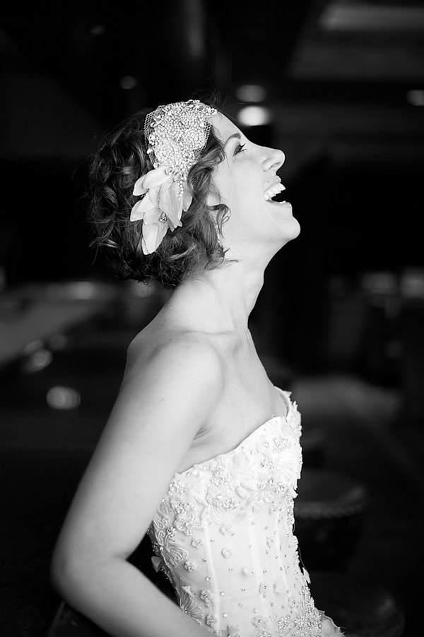 beautiful bridal portraits by top Houston wedding photographer Adam Nyholt, ruffled wedding dress and stylish wedding hair accessory