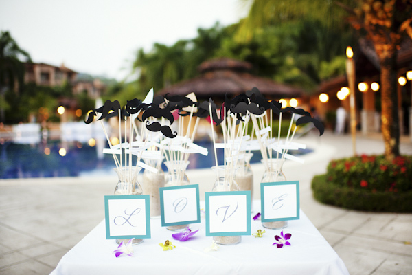 fun moustache props, outdoor wedding reception - Marriott Los Suenos beach resort - Costa Rica - photo by Denver based destination wedding photographer Otto Schulze