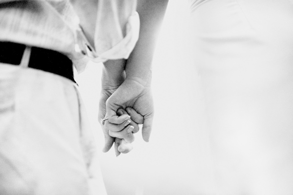 closeup perspective, black and white photo of the happy couple holding hands - photo by Denver based destination wedding photographer Otto Schulze