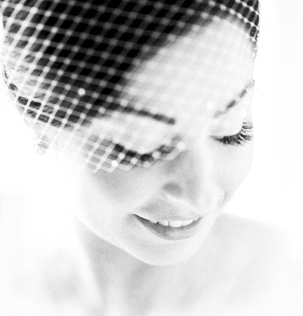 beautiful closeup, black and white photo of bride in birdcage veil - photo by Denver based destination wedding photographer Otto Schulze
