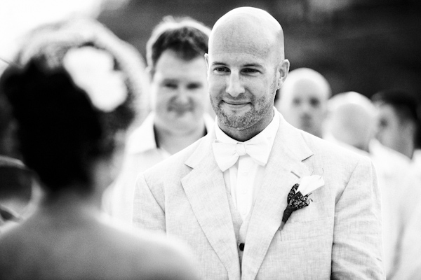 black and white portrait of handsome groom during beach ceremony - Costa Rica destination wedding - photo by Denver based destination wedding photographer Otto Schulze