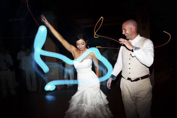 creative photo of the happy couple dancing together with light trails in photo - photo by Denver based destination wedding photographer Otto Schulze