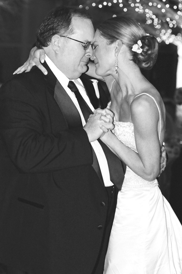 emotional wedding image, father-daughter dance by Positive Light Photography