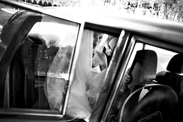 genius car window reflection wedding photo by North Carolina and destination wedding photographers Tracy Turpen Photography
