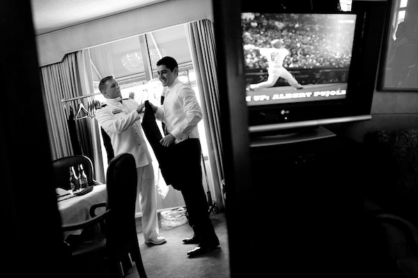 fun portrait of groom getting ready with groomsmen with baseball game on tv - that's genius wedding image by Austin wedding photographer Ashley Garmon