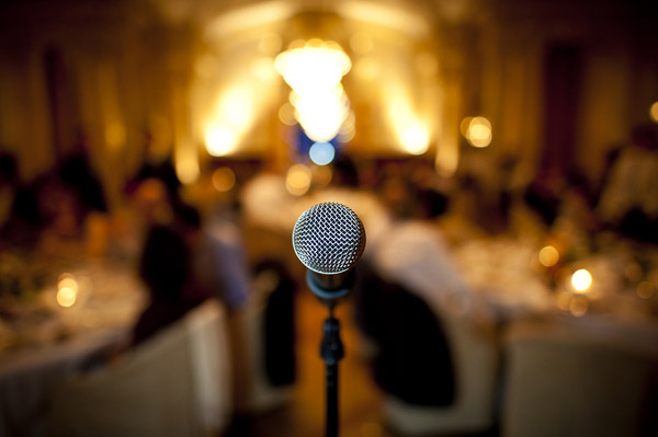 creative wedding reception speech photo by top Switzerland wedding photographer Magnus Bogucki