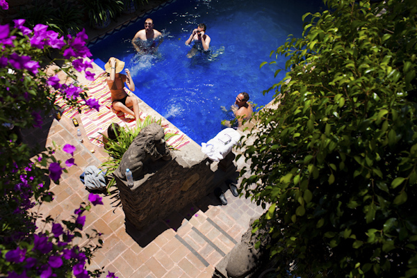 beautiful destination wedding in San Miguel, Mexico - poolside at Casa Schuck - photo by top California wedding photographer Brett Butterstein