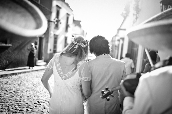black and white photo of the happy couple walking down cobblestone street after ceremony - beautiful destination wedding in San Miguel, Mexico - photo by top California wedding photographer Brett Butterstein