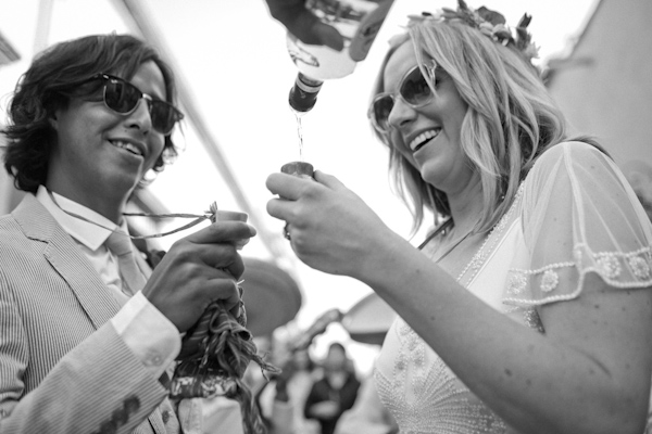 beautiful destination wedding in San Miguel, Mexico - black and white photo of the happy couple pouring tequila after ceremony - photo by top California wedding photographer Brett Butterstein