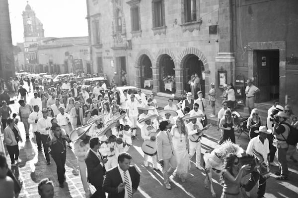 black and white photo of customary wedding tequila parade - beautiful destination wedding in San Miguel, Mexico - photo by top California wedding photographer Brett Butterstein