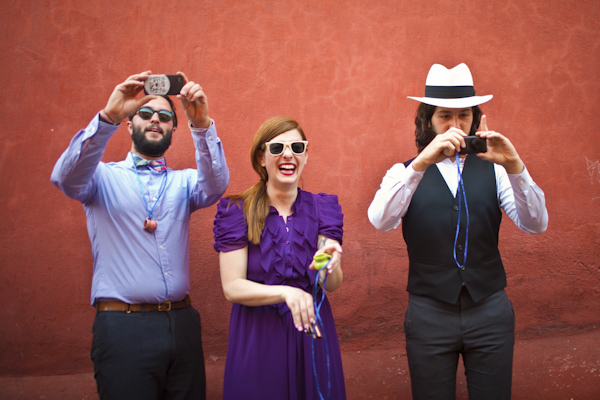 fun color photo of smiling guests taking photos - beautiful destination wedding in San Miguel, Mexico - photo by top California wedding photographer Brett Butterstein