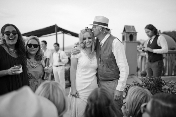 black and white photo of smiling bride with doting father - beautiful destination wedding in San Miguel, Mexico - photo by top California wedding photographer Brett Butterstein
