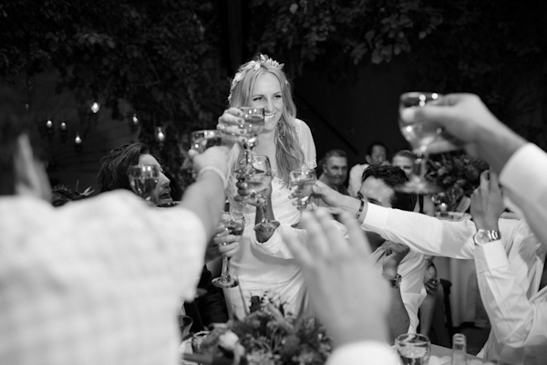 beautiful destination wedding in San Miguel, Mexico - black and white photo of bride toasting at reception - photo by top California wedding photographer Brett Butterstein