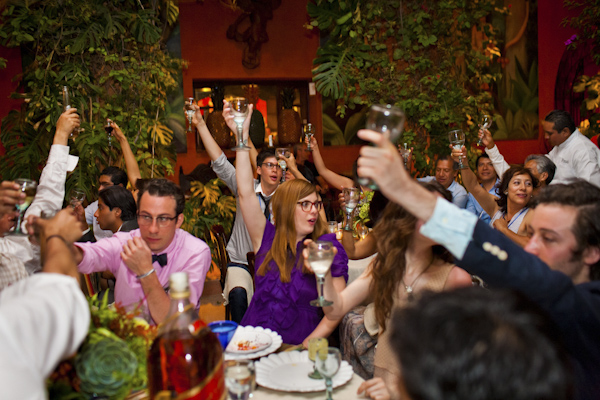 reception guests toasting the happy couple - beautiful destination wedding in San Miguel, Mexico - photo by top California wedding photographer Brett Butterstein
