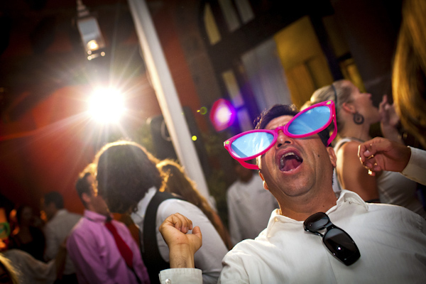 hilarious wedding reception shot of guy in oversized sunglasses - beautiful destination wedding in San Miguel, Mexico - photo by top California wedding photographer Brett Butterstein