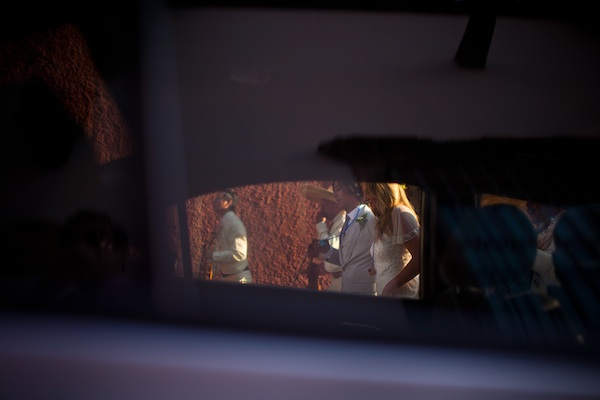 creative shot of the happy couple through a car window - beautiful destination wedding in San Miguel, Mexico - photo by top California wedding photographer Brett Butterstein