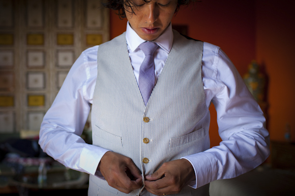 beautiful destination wedding in San Miguel, Mexico - groom getting dressed before ceremony - photo by top California wedding photographer Brett Butterstein