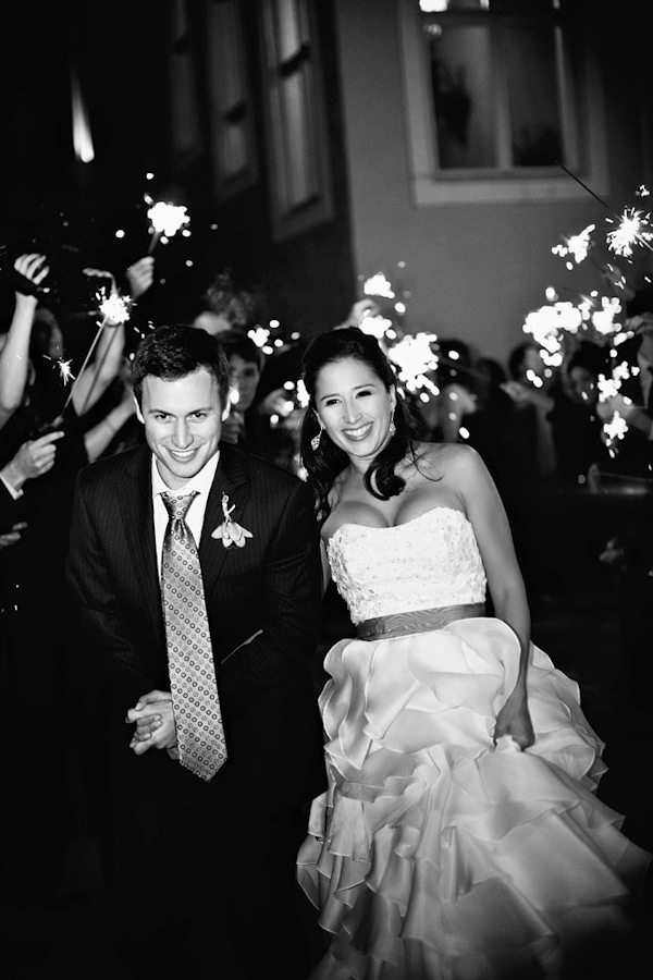 black and white photo of the happy couple in grand sparkler wedding exit - photo by top Florida based photographers La Dolce Vita Studio