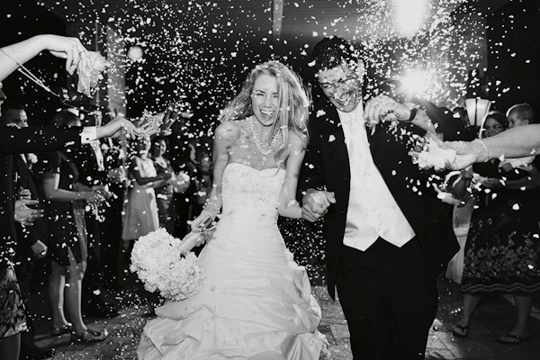 black and white photo of the happy couple in flower petal grand wedding exit - photo by top Dallas, Texas based photographer Jeremy Gilliam