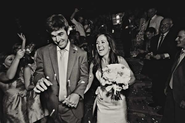 black and white photo of the happy couple in hilarious marshmallow grand wedding exit - photo by top Greensboro, North Carolina based photographers Whitebox Weddings