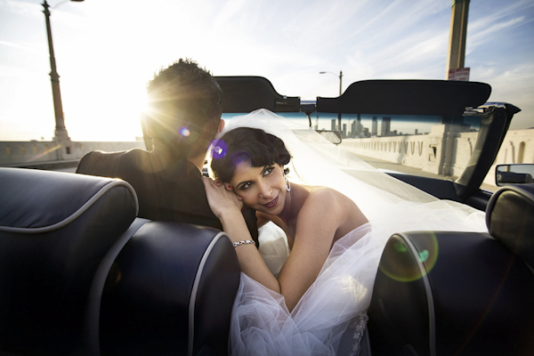photo from backseat of the happy couple driving away after grand wedding exit - photo by top Southern California based photographer Duke Photography