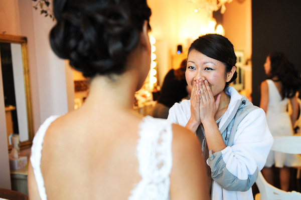 bride and bridesmaid getting ready for the wedding, photo by Kenny Nakai Photography