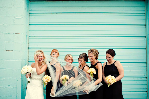 hilarious bridesmaids and wedding veil in the wind photo by Dan Stewart Photography