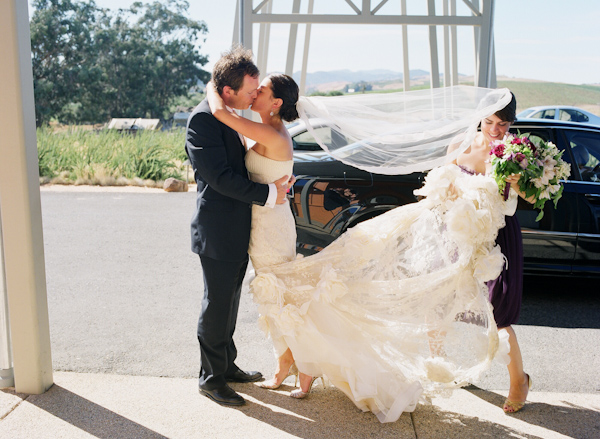Hilarious windy wedding day photo by Meg Smith