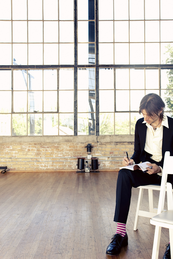 portrait of groom writing vows before ceremony - hip, modern Jewish wedding at the Ravenswood Event Center in Chicago - photos by Studio 6.23