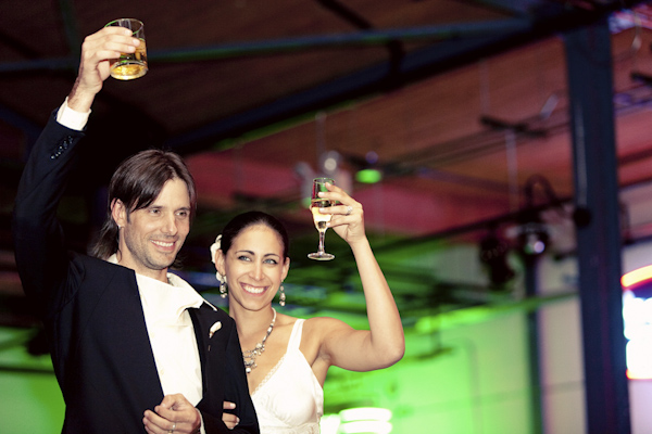 the happy couple toasting during wedding reception - hip, modern Jewish wedding at the Ravenswood Event Center in Chicago - photos by Studio 6.23