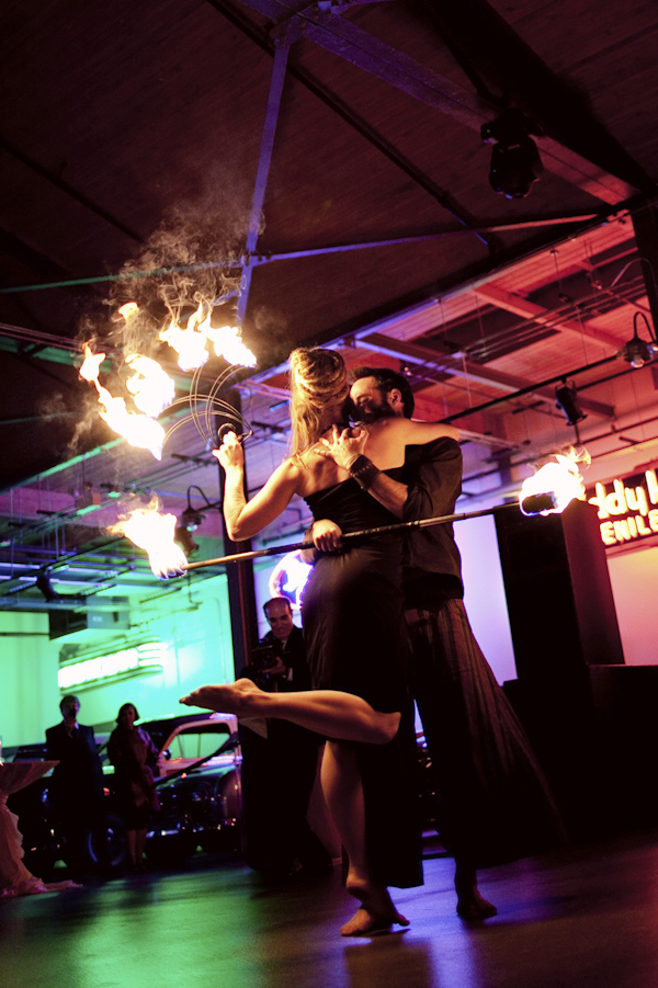 wedding reception fire dancer performance - modern Jewish wedding at the Ravenswood Event Center in Chicago - photos by Studio 6.23