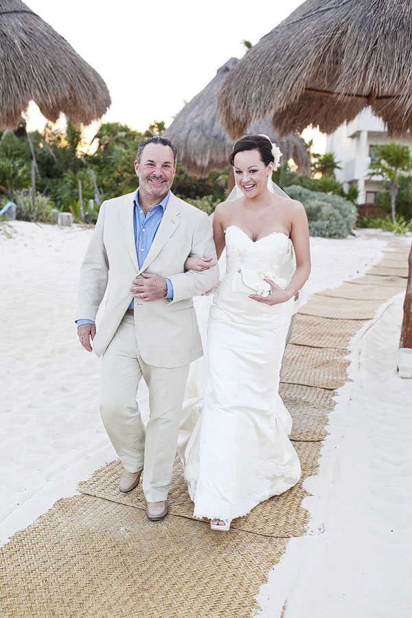 proud father walking bride down aisle - beach ceremony entrance - Riviera Maya, Mexico destination wedding - photo by Dallas based wedding photographer Jeremy Gilliam