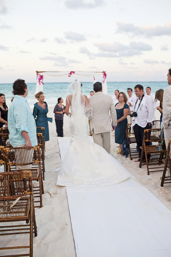 beach ceremony - bride walking down aisle with father - Riviera Maya, Mexico destination wedding - photo by Dallas based wedding photographer Jeremy Gilliam