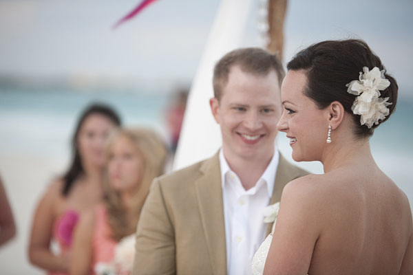closeup portrait of smiling bride and groom during beach ceremony - Secrets Resort Riviera Maya, Mexico destination wedding - photo by Dallas based wedding photographer Jeremy Gilliam