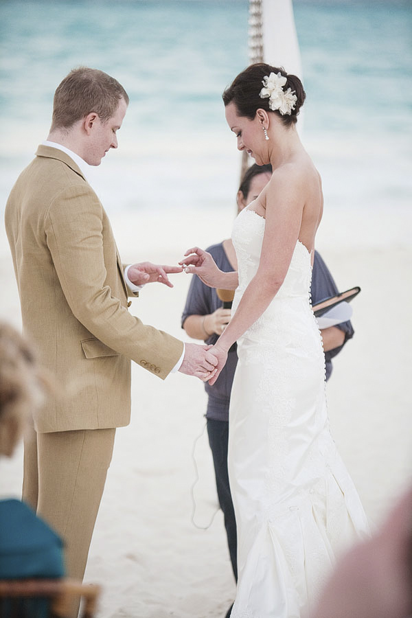 bride putting wedding ring on groom - ceremony rituals - Riviera Maya, Mexico destination wedding - photo by Dallas based wedding photographer Jeremy Gilliam