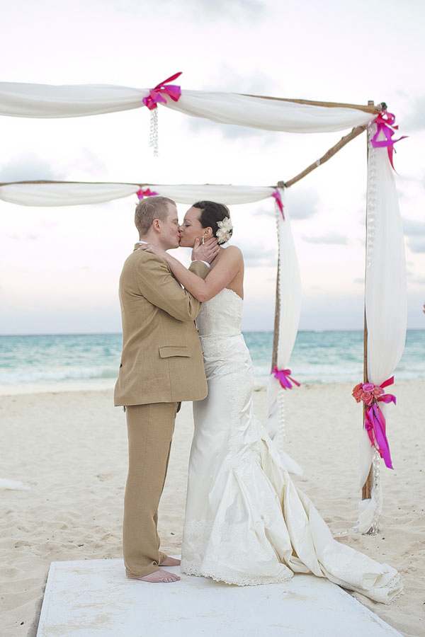 beach ceremony - the kiss - Riviera Maya, Mexico destination wedding - photo by Dallas based wedding photographer Jeremy Gilliam