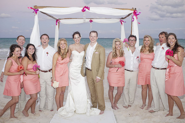 wedding party in tan and salmon pink colors - group portrait - beach ceremony - Riviera Maya, Mexico destination wedding - photo by Dallas based wedding photographer Jeremy Gilliam
