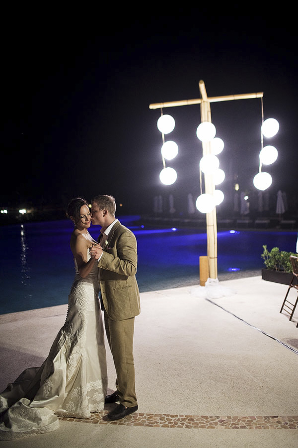 night shot of the happy couple dancing together poolside - Riviera Maya, Mexico destination wedding - photo by Dallas based wedding photographer Jeremy Gilliam