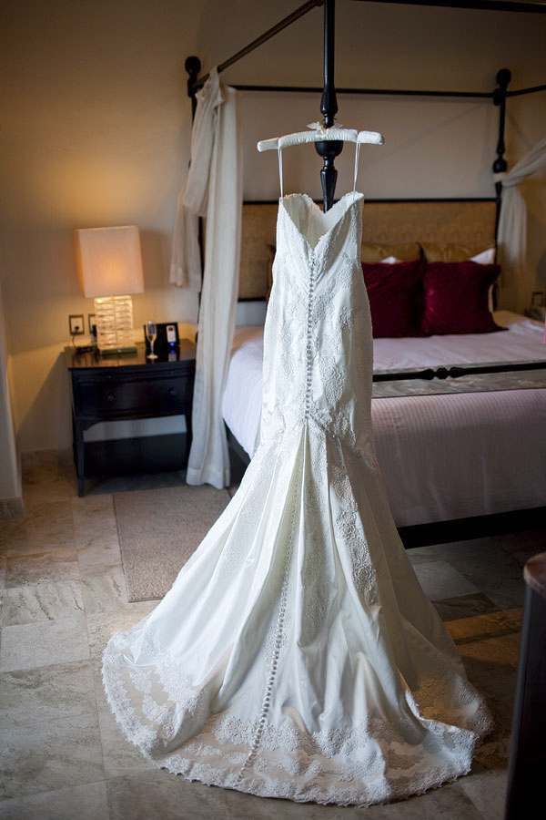 white wedding dress hanging - Secrets Resort - Riviera Maya, Mexico destination wedding - photo by Dallas based wedding photographer Jeremy Gilliam