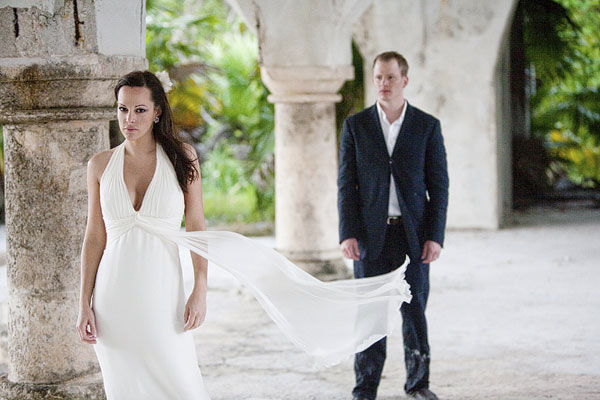 classic color photo of beautiful bride in flowing white gown standing in front of groom - Secrets Beach Resort - Riviera Maya, Mexico destination wedding - photo by Dallas based wedding photographer Jeremy Gilliam