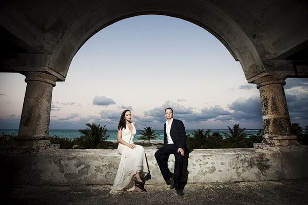bride and groom posed under gorgeous archway - Secrets Maroma Beach Resort - Riviera Maya, Mexico destination wedding - photo by Dallas based wedding photographer Jeremy Gilliam