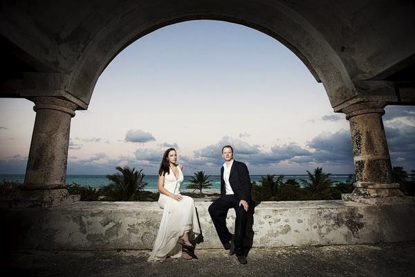 bride and groom posed under gorgeous archway - Secrets Maroma Beach Resort - Riviera Maya, Mexico destination wedding - photo by Dallas based wedding photographer Jeremy Gilliam