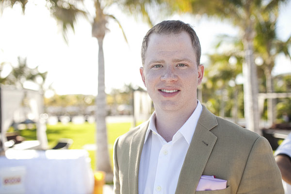 classic color portrait of groom in tan suit - Riviera Maya, Mexico resort destination wedding - photo by Dallas based wedding photographer Jeremy Gilliam