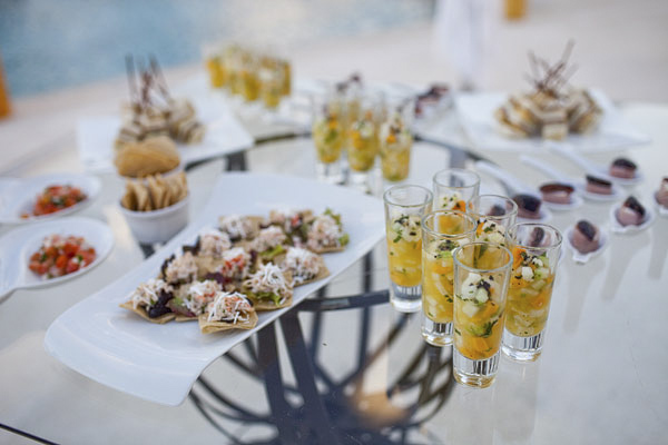 outdoor wedding reception, cocktail hour food detail shot - Secrets Resort Riviera Maya, Mexico destination wedding - photo by Dallas based wedding photographer Jeremy Gilliam