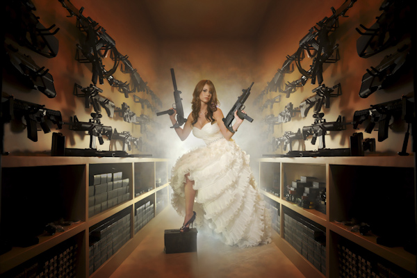 alternative bridal portrait, bride posed in armory with machine guns - fine art wedding photo by top Dallas based photographer Paul Ernest