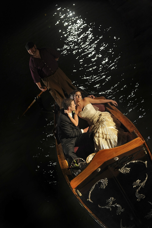 romantic couple's portrait - bride and groom in gondola at night - fine art wedding photo by top Dallas based photographer Paul Ernest